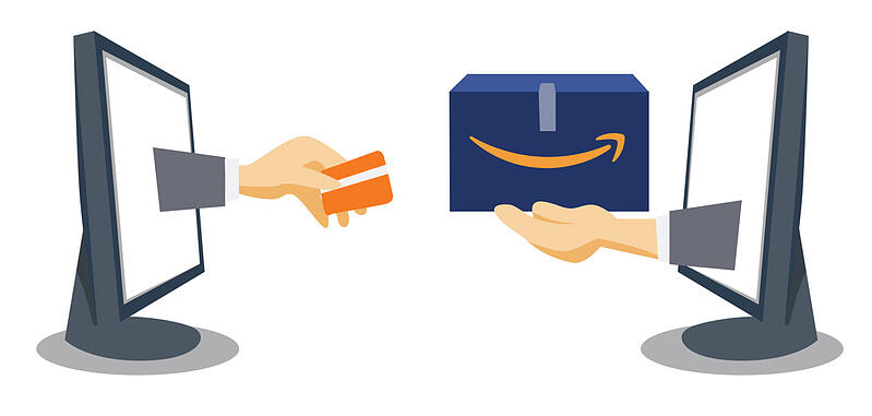 Two computer monitors with hands coming from the screens with a credit card and Amazon box